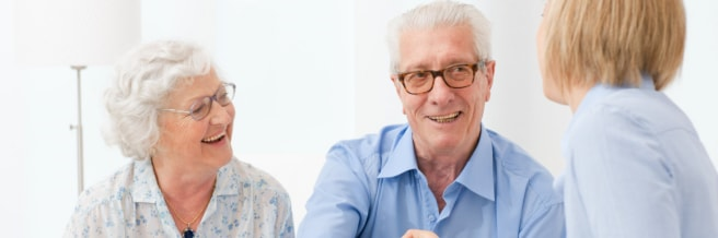 Elderly couple talking to a pharmacist