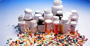 Medicine bottles surrounded by medicine tablets and capsules
