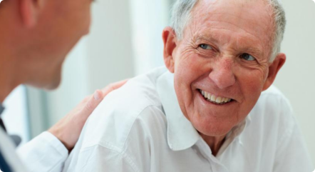 An elderly talking to a pharmacist